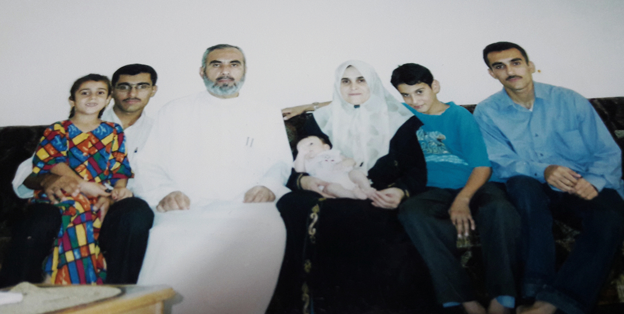 This picture is from 2001. The baby is my youngest sister who was just a few month old. Only my oldest sister is missing because she had got married and was living in Qatar.